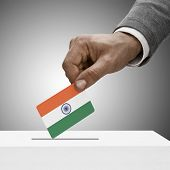 Black Male Holding Flag. Voting Concept - India