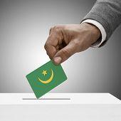 Black Male Holding Flag. Voting Concept - Mauritania