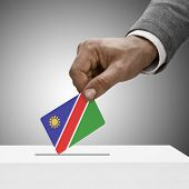 Black Male Holding Flag. Voting Concept - Namibia