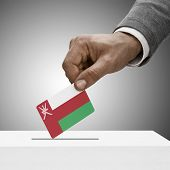 Black Male Holding Flag. Voting Concept - Oman