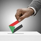 Black Male Holding Flag. Voting Concept - Sudan