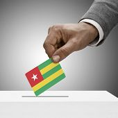 Black Male Holding Flag. Voting Concept - Togo