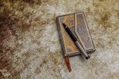 Ornamented Aged Diary With Pen