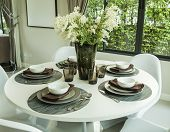 Dining Table And Artificial Flower In Modern Dining Room