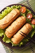Spring Rolls Fried On Lettuce With Tomatoes Vertical, Top View