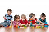 picture of 5s  - Five clever children are playing on the floor in the kindergarten - JPG