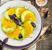 image of hazelnut  - Appetizer of avocado and orange with purple basil and hazelnuts - JPG