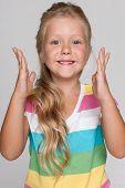 Joyful Little Girl On The Gray Background