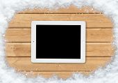 tablet on a snow-covered surface