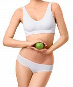 Slim woman in white underwear with green apple at her hands over isolated background
