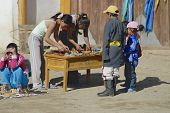 People sell souvenirs at the entrance to the Erdene Zuu monastery in Kharkhorin,