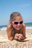 Adorable toddler girl  on sand beach