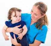 pic of babysitter  - Babysitter holding in arms an adorable baby girl - JPG