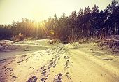 Footprints On Sand, Retro Stylized Nature Background With Flare Effect.