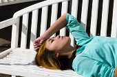 pic of recliner  - Asian American Woman Outdoors Reclining Profile Eyes Closed - JPG