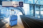 Departure For Turin, Italy. Blue Suitcase At The Railway Station