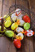 pic of bucket  - Easter eggs in bucket on dark wooden background - JPG