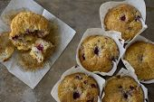 Raspberry Muffins from Above with one Eaten