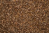 Surface covered with coffee beans as a background