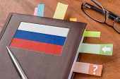 Notebook on a desk with the flag of Russia