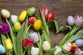 Easter tulips with heart shape and eggs abstract concept