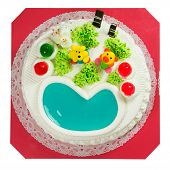 stock photo of fancy cake  - Fancy cake with sugar cartoon and jelly heart isolated on white background - JPG