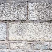 Old limestone brick wall fragment