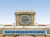 DAKAR, SENEGAL, AFRICA - JULY 20, 2014 - Clock, abandoned railway station, colonial building