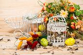 Easter Still Life. Bird Cage With Quail Eggs And Spring Flowers