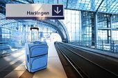 Departure For Harlingen, Netherlands. Blue Suitcase At The Railway Station