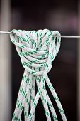 picture of lifeline  - A mooring rope with a knotted end tied around a lifeline