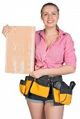Woman in tool belt holding ceramic tile