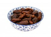 Whole Dates In A Blue And White China Bowl