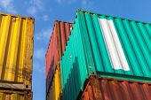 Colorful Metal Cargo Containers Under Blue Cloudy Sky