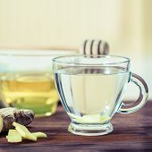Ginger  Tea And Honey On Wooden Table