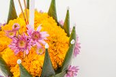 stock photo of floating  - Krathong the hand crafted floating candle made of floating part decorated with green leaves colorful flowers and many sorts of creative materials  - JPG