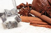stock photo of christmas spices  - Spice for baking anise and cinnamon cookie cutters dough for gingerbread and Christmas cookies lying on white flour concept for baking and christmas time - JPG