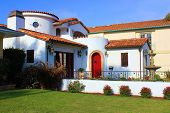 image of manicured lawn  - Older historical Spanish style house with manicured landscaping taken in a California neighborhood - JPG