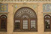stock photo of tehran  - decorated window in the 19th century Golestan palace in Tehran - JPG