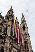 stock photo of gay symbol  - Vienna Town Hall with Gay Pride Flag symbol on historic building for tolerance and acceptance - JPG