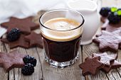 stock photo of whole-wheat  - Coffee in a glass with whole wheat chocolate cookies - JPG