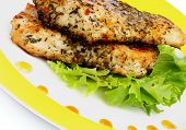 image of spit-roast  - Roasted Chicken Fillets with Herbs Lettuce and Honey Sauce on Yellow Plate closeup - JPG