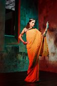 foto of indian beautiful people  - Young beautiful woman in bright Indian costume - JPG
