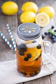 image of masonic  - Ice tea in mason jar mug with lemon and blueberries refreshing in hot summer day - JPG