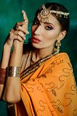 pic of indian beautiful people  - Young beautiful woman in bright Indian costume - JPG