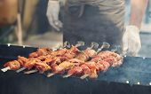 image of barbecue grill  - juicy delicious Grilled meat steaming on barbecue
