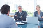 stock photo of conduction  - Business people conducting an interview in an office - JPG