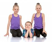 pic of little sister  - Two sisters twins sit next to his little brother - JPG