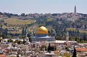 stock photo of israel people  - Landscape view of the Dome of the Rock Mosque on Temple Mount against mount of Olives in Jerusalem old city Israel - JPG