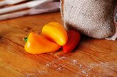 picture of yellow-pepper  - red and yellow ripe peppers lies on wooden cutting board - JPG
